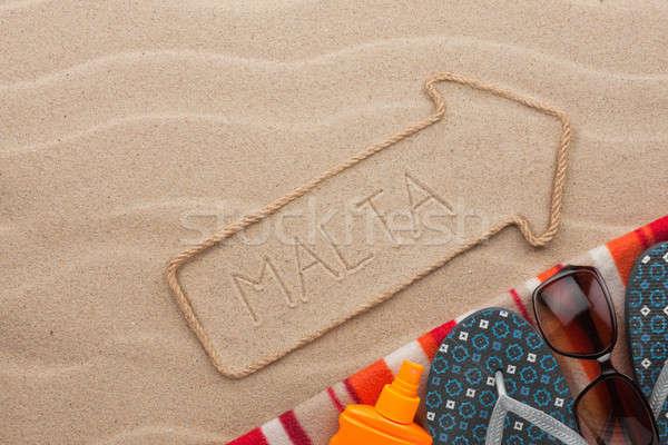 Malta  pointer and beach accessories lying on the sand Stock photo © alekleks