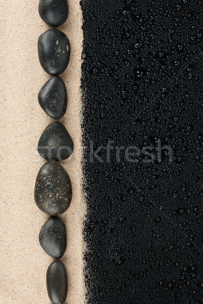 Zen stones on the sand and water droplets Stock photo © alekleks