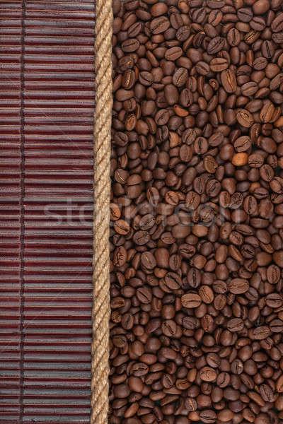 Coffee beans  lying on dark bamboo mat, for menu Stock photo © alekleks