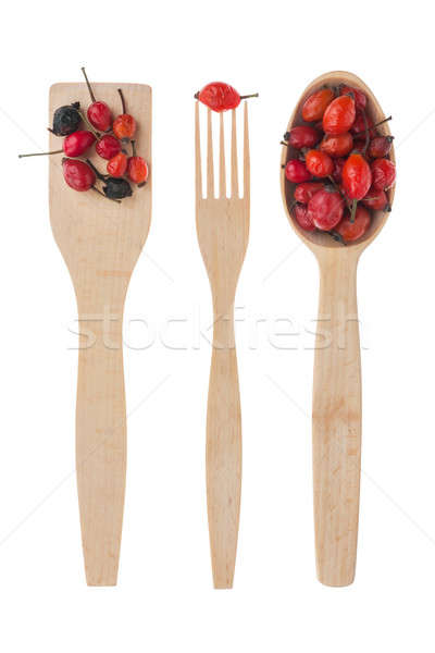 Wooden spoon, fork, paddle with  rosehips Stock photo © alekleks