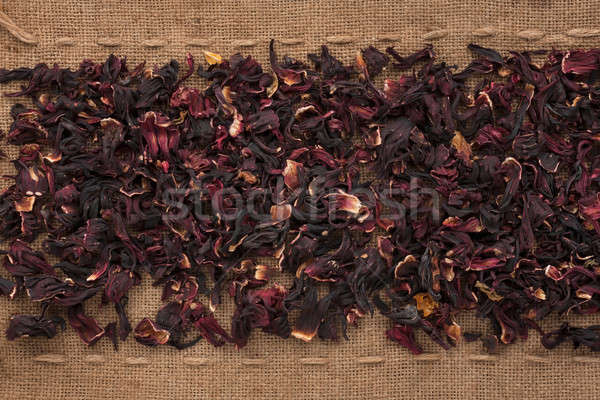 Hibiscus  lying on sackcloth between the lines Stock photo © alekleks