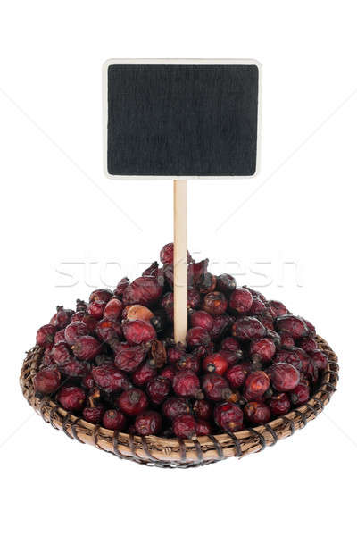 Heap of   rosehip  in a plate, with a pointer for your text Stock photo © alekleks