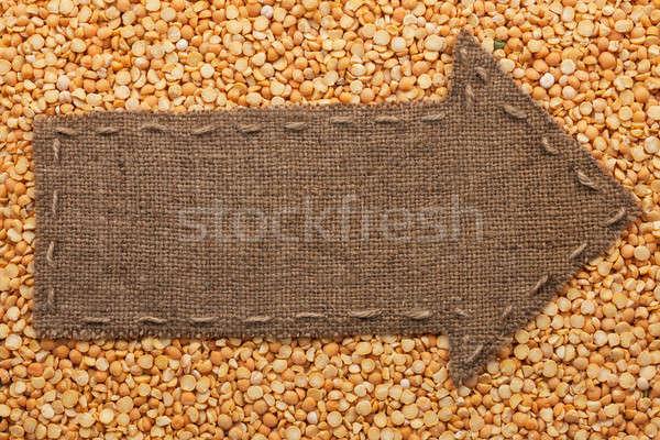 Pointer of  burlap lies on dried peas Stock photo © alekleks