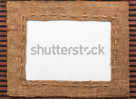 Frame made of burlap with the line and  rice  grain  lies on whi Stock photo © alekleks