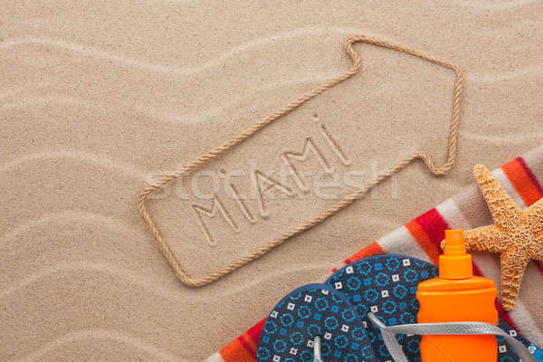 Miami pointer and beach accessories lying on the sand Stock photo © alekleks