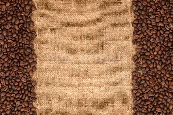 Coffee beans lying on sackcloth  Stock photo © alekleks