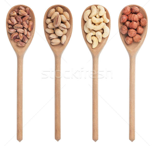 Four wooden spoons with pistachios, cashews and hazelnuts  Stock photo © alekleks
