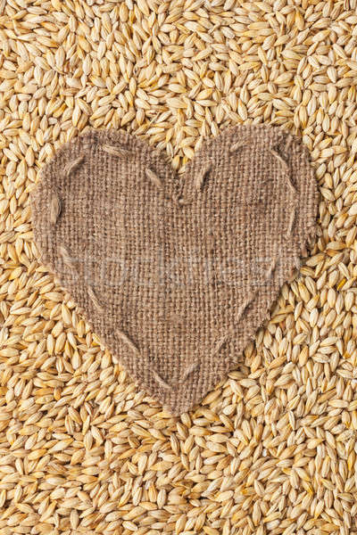 Frame in the shape of heart made of burlap with barley Stock photo © alekleks