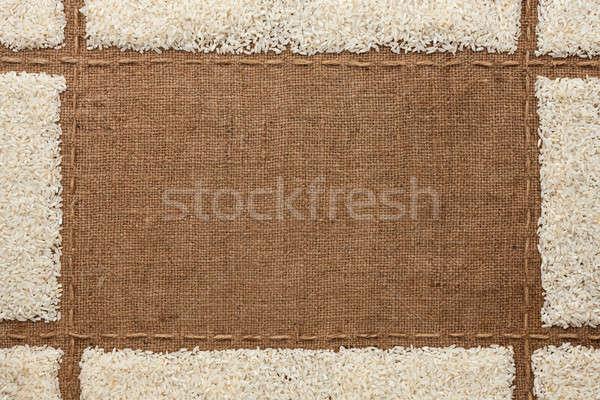 Beautiful frame with rice  on sackcloth Stock photo © alekleks