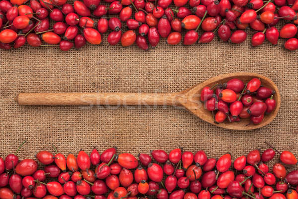 Wooden spoon with rosehip  lies on  sackcloth Stock photo © alekleks