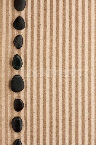Fekete kövek hazugság homok konzerv használt Stock fotó © alekleks