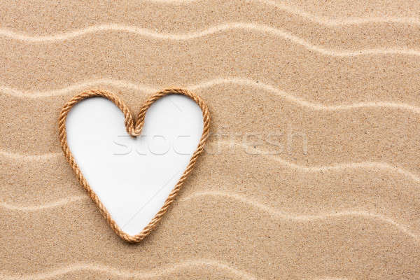Heart made of rope with a white background on the sand Stock photo © alekleks