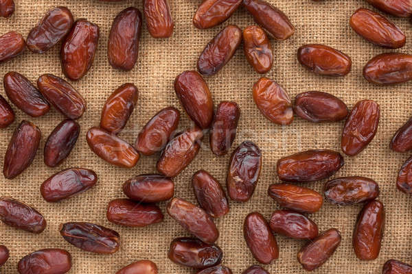 Background, dates  lying on sackcloth Stock photo © alekleks