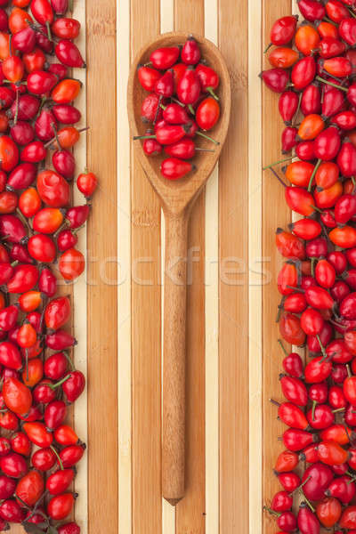 Wooden spoon with rosehip Stock photo © alekleks