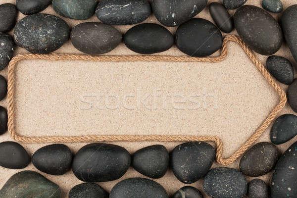 Pointer made of rope with  black stones Stock photo © alekleks