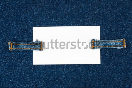 Business card with two straps  jeans, lies on the dark denim Stock photo © alekleks