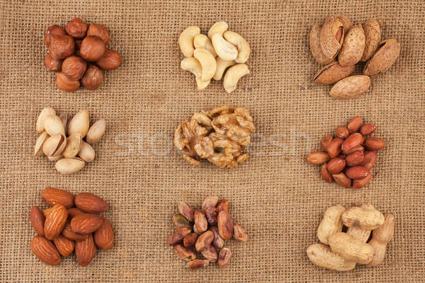 Assorted nuts lying on burlap Stock photo © alekleks