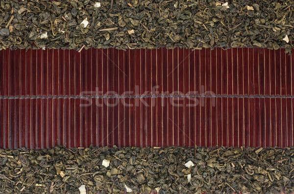 Dried  green tea  on a dark  bamboo mat Stock photo © alekleks