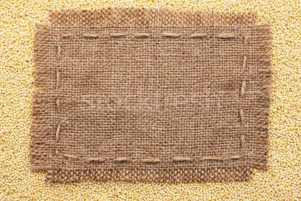 Frame of burlap  lying on a millet  background Stock photo © alekleks