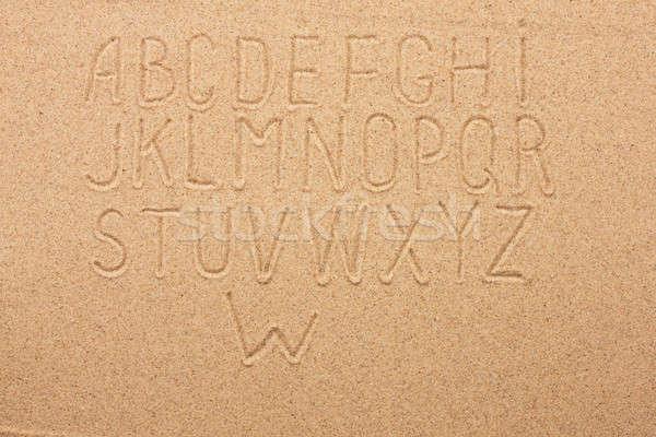 английский алфавит написанный песок природы дизайна Сток-фото © alekleks