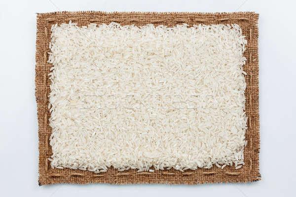 Frame of burlap and rice grain Stock photo © alekleks