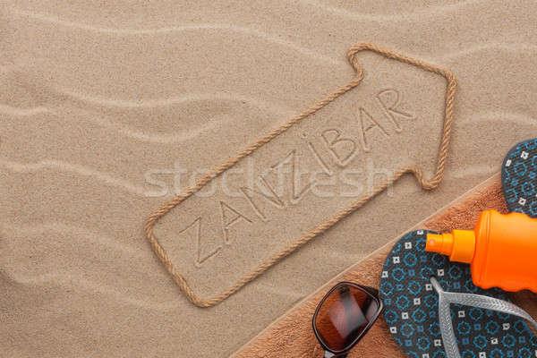 Zanzibar  pointer and beach accessories lying on the sand Stock photo © alekleks