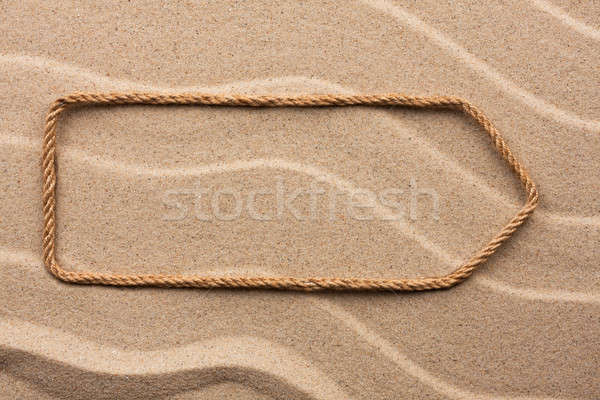 Pointer made of rope on the sand Stock photo © alekleks