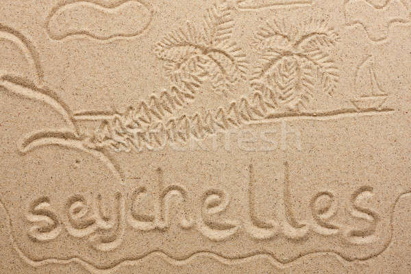 Stock photo: Seychelles handwritten from  sand