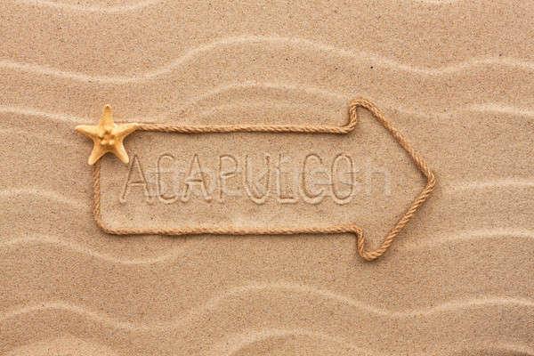 Nyíl kötél tenger kagylók szó homok Stock fotó © alekleks
