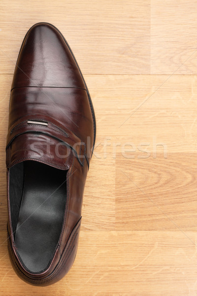 Classic mens shoes stand on the wooden floor Stock photo © alekleks