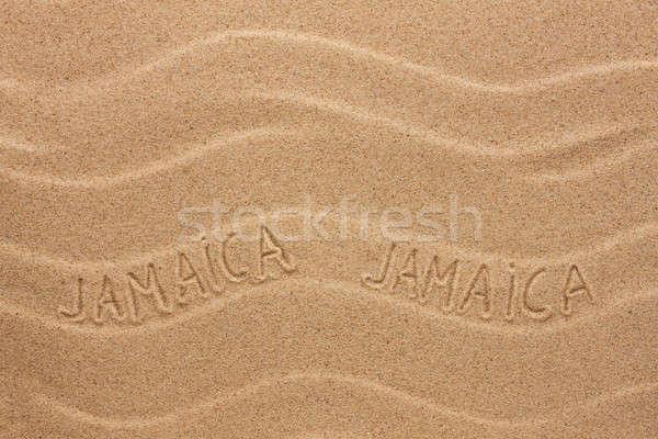 Jamaica  inscription on the wavy sand Stock photo © alekleks