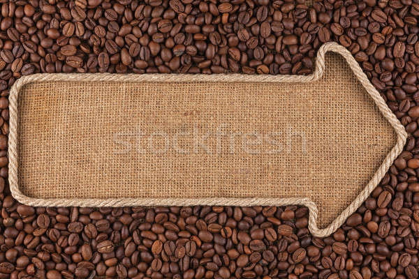 Pointer made from rope with  coffee beans  lying on sackcloth Stock photo © alekleks