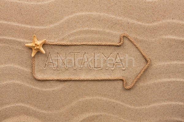 Arrow made of rope and starfish with the word Antalya on the san Stock photo © alekleks