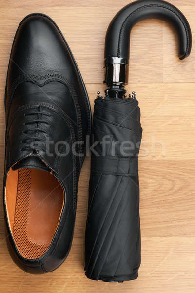 Classic mens shoes and  umbrella  on the wooden floor Stock photo © alekleks