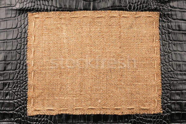 Frame of burlap, lies on a background of black leather Stock photo © alekleks