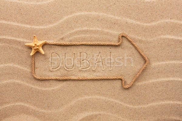 Nyíl kötél tenger kagylók szó Dubai Stock fotó © alekleks