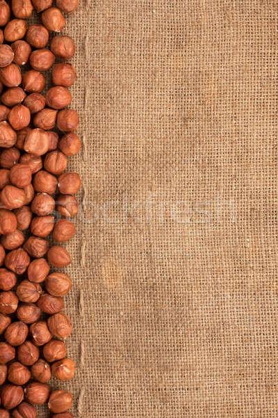Stitching and sewing hazelnut lying on sackcloth Stock photo © alekleks