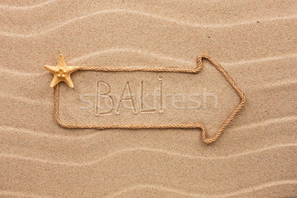 Arrow made of rope and sea shells with the word Bali on the sand Stock photo © alekleks