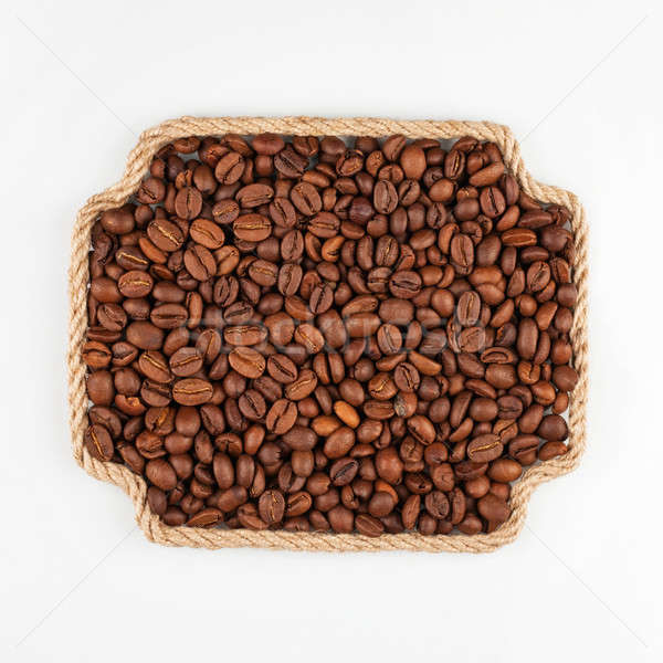 Frame made of rope with coffee  beans  lying on a white backgrou Stock photo © alekleks