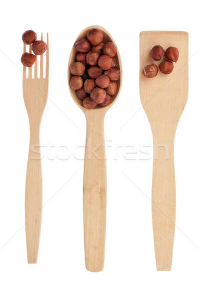 Wooden spoon,fork, shovel with filbert Stock photo © alekleks
