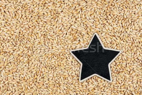 Star ,pointer, price, tag, lies on barley Stock photo © alekleks