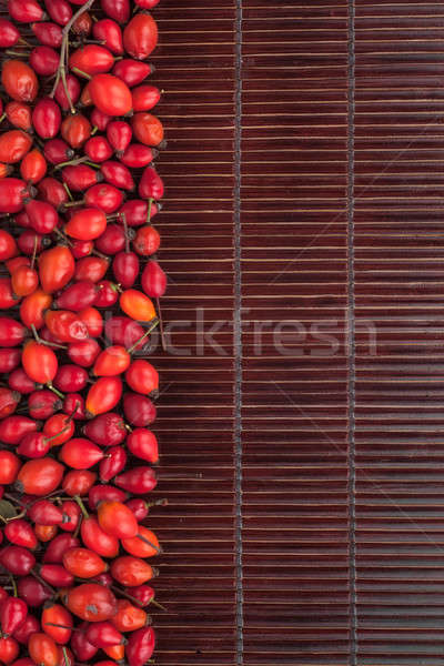 Rosehip on a dark  bamboo mat Stock photo © alekleks