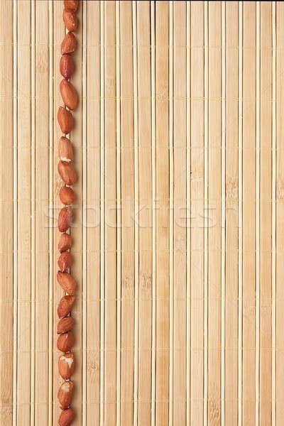 Cases a band of peanut lying on bamboo mat Stock photo © alekleks