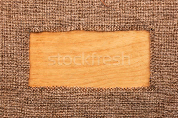 Frame made of burlap  lying on a wooden surface Stock photo © alekleks