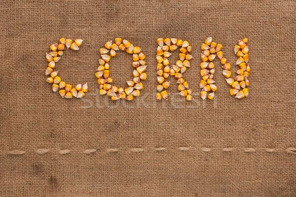 Stock photo: Corn word written on sackcloth