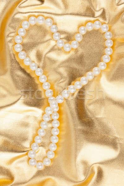 Symbolisch hart goud weefsel liefde ontwerp Stockfoto © alekleks