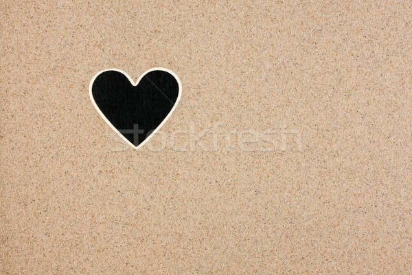 Pointer, ads board in the form heart  in the sand Stock photo © alekleks