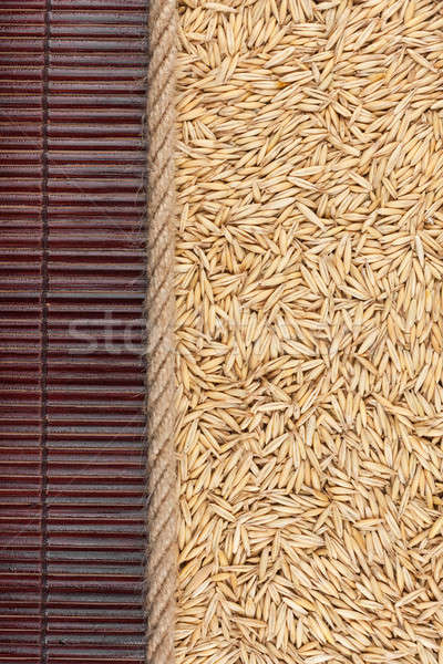 Oat  lying on dark bamboo mat, for menu Stock photo © alekleks