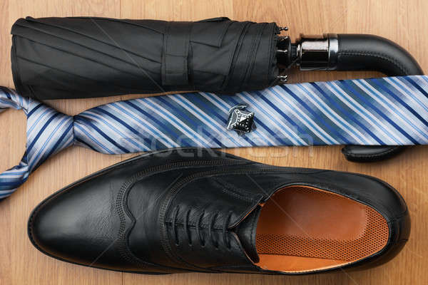 Classic mens shoes, tie, umbrella,cufflinks on the wooden floor Stock photo © alekleks