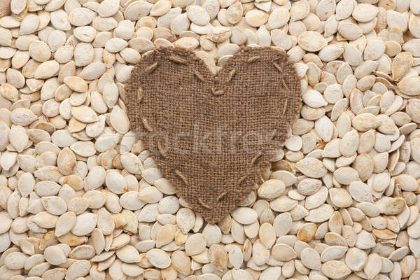 Marco forma corazón arpillera calabaza semillas Foto stock © alekleks